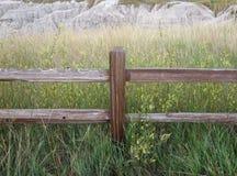 The badlands behind a farm meadow Royalty Free Stock Photos