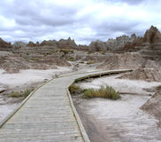 Badlands Boardwalk. This wooden boardwalk loops through a section of the South Dakota Badlands National Park Royalty Free Stock Image