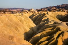 Badlands formations of Zabriskie Point, ancient desert colourful landscape, surreal landscape of world`s lifeless hottest place stock image