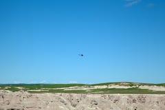 The Badlands. A helicopter flying over the Badlands of South Dakota stock images