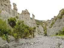 Badlands hoodoos of Putangirua Pinnacles, NZ. Badland erosion of soft conglomerate sediment formations called Putangirua Pinnacles in the Aorangi Ranges, North Stock Photos