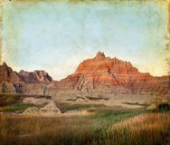 Badlands Mountains on a Grunge Background Royalty Free Stock Image