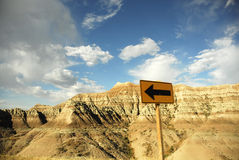 Badlands National Park. Scenic view of rock formations in Badlands National park with directional signpost in foreground, South Dakota, U.S.A Stock Photos