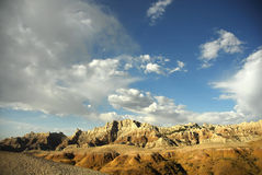 Badlands National Park. Scenic view of rock formations in Badlands National Park with blue sky and cloudscape background, South Dakota, U.S.A Stock Images