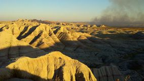 Badlands National Park. Controlled fire in the Badlands National Park at sunset royalty free stock photo