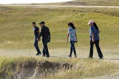 A family enjoying of hiking in Badlands National Park, South Dakota. stock image