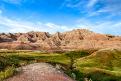 This is Badlands National Park in South Dakota. There are spectacular rock formations, canyons, and pinnacles. These rock formations form steep cliffs stock images