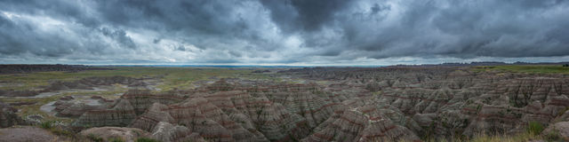 Badlands Overlook Panorama. Panorama of ominous clouds over Badlands in South Dakota Royalty Free Stock Photo
