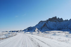 The Badlands road trip in November. The Badlands road trip covered with snow in November Royalty Free Stock Photography