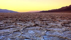 Badlands salt pan at sunset, Death Valley National Park, California stock video footage