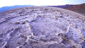 Badlands salt pan at sunset, Death Valley National Park, California stock video