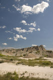 Badlands of South Dakota. Scenic view of badlands of South Dakota with mountain range in background, U.S.A Stock Photos