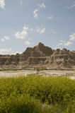 Badlands of South Dakota. Scenic view of Badlands of South Dakota with mountains in background, U.S.A Stock Images