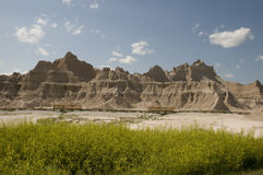 Badlands in South Dakota. With Blue Sky and Green Grass Royalty Free Stock Images