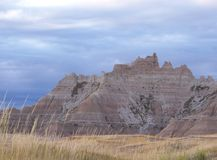 Badlands. The Badlands in South Dakota with a meadow in front of the rock formations Stock Image