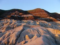 Badlands at sunset Stock Images