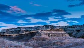 Badlandsnationalparken South Dakota efter solnedgångmedicin rotar T arkivfoto