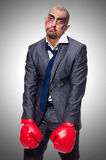 Badly beaten businessman. With boxing gloves Royalty Free Stock Images