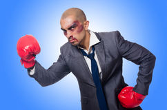 Badly beaten businessman. With boxing gloves Royalty Free Stock Photo