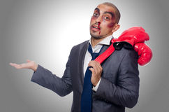Badly beaten businessman. With boxing gloves Stock Photography