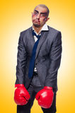 Badly beaten businessman. With boxing gloves Stock Image
