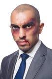 Badly beaten businessman isolated Royalty Free Stock Photo