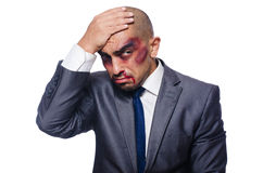 Badly beaten businessman isolated Royalty Free Stock Images