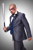 Badly bruised businessman with bat. On white Royalty Free Stock Images