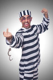 Badly bruised prisoner. With handcuffs Stock Photography