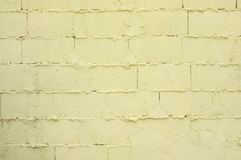 Badly built pale yellow brick wall.  Royalty Free Stock Photos