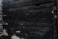 Badly burned, the house wall close up stock images