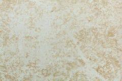 Badly damaged beige cardboard texture. Beige background Royalty Free Stock Photo