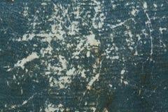 Badly damaged dark blue cardboard texture.  Royalty Free Stock Image