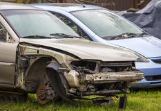 Badly damaged rusted car after road accident.  Stock Photography