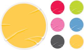 Badly glued old blank stickers. Set of colorful round stickers. Crumpled and badly glued Stock Photos