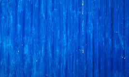 Badly painted waved metal sheet blue background. Badly painted waved metal sheet background. Vertical rolling direction, blue color Stock Images