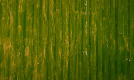 Badly painted waved metal sheet green background Stock Photography