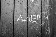 Badly spelled grafitti. On a wooden door Royalty Free Stock Photography