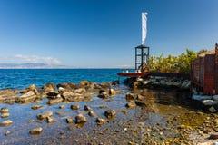 Badmeester tover en boot in Reggio Calabrië Stock Afbeeldingen