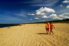 Badmeesters bij de kust Stock Foto's