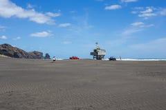 Badmeestertoren op een strand Stock Afbeelding