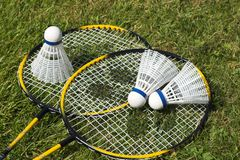 Badminton. Equipment laid out on grass stock photo