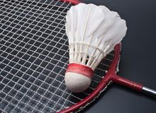 Badminton. Racket and shuttlecock isolated on a black background Royalty Free Stock Image
