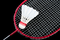 Badminton. Racket and shuttlecock isolated on a black background Stock Photo