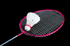 Badminton. Racket and shuttlecock isolated on a black background Royalty Free Stock Photo