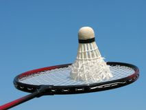 Badminton. Shuttlecock on a badminton racket over blue sky Royalty Free Stock Photography