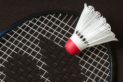 Badminton. Closeup shot of badminton racket and birdie Royalty Free Stock Photography