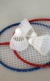 Badminton. Badminton rackets and shuttlecocks with grey background stock photos