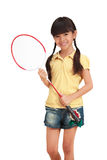Badminton. Smiling little girl holding a badminton racket, Isolated on white Stock Photos