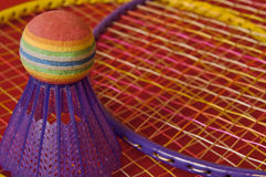 Badminton. Isolated badminton birdie and rackets on red background Royalty Free Stock Photos